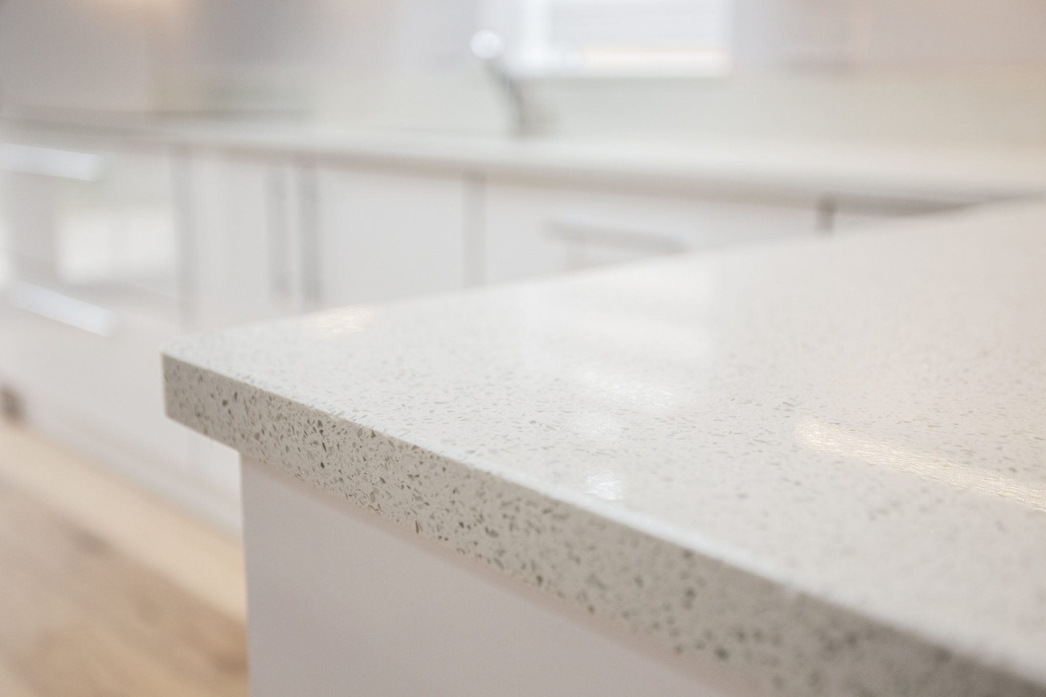 image of white unit new kitchen installation with quartz worktop