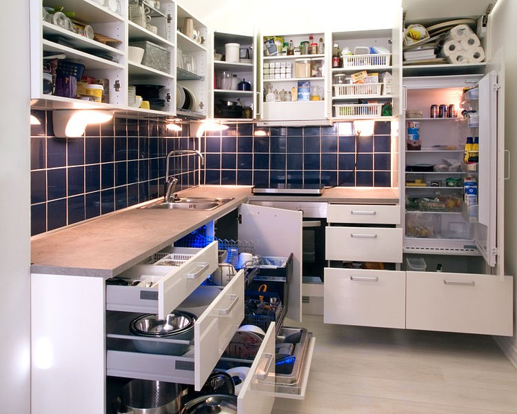 image of open white kitchen cabinets and drawers
