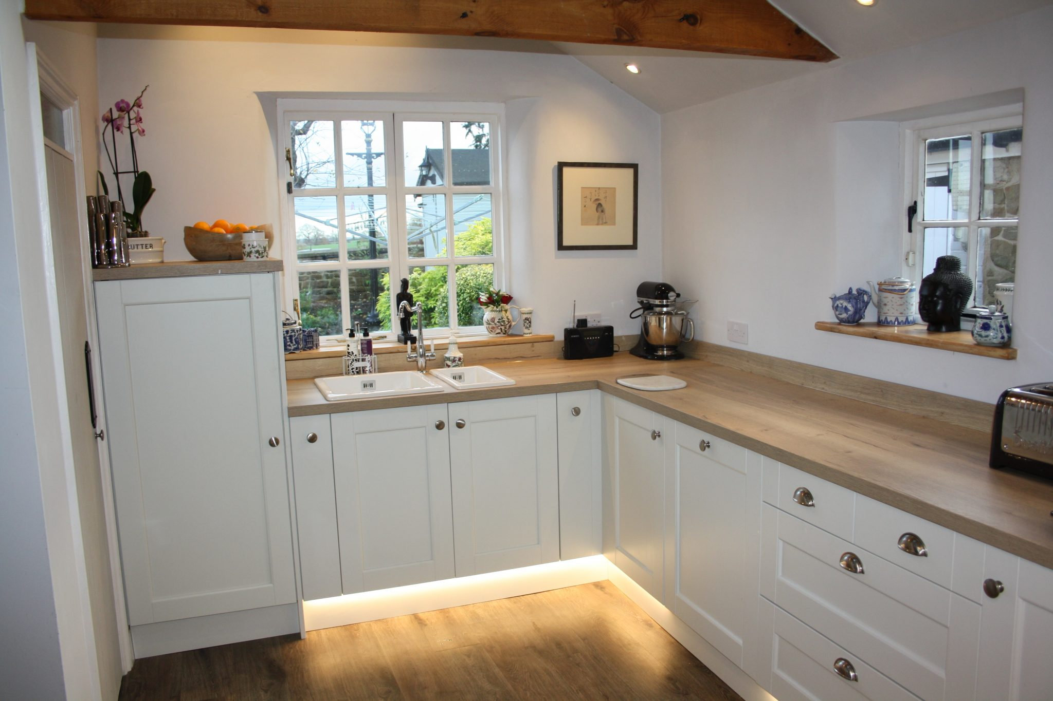 Wooden Worktops with White Storage Kitchen
