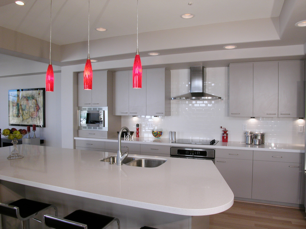 image of white kitchen installation with pale grey units