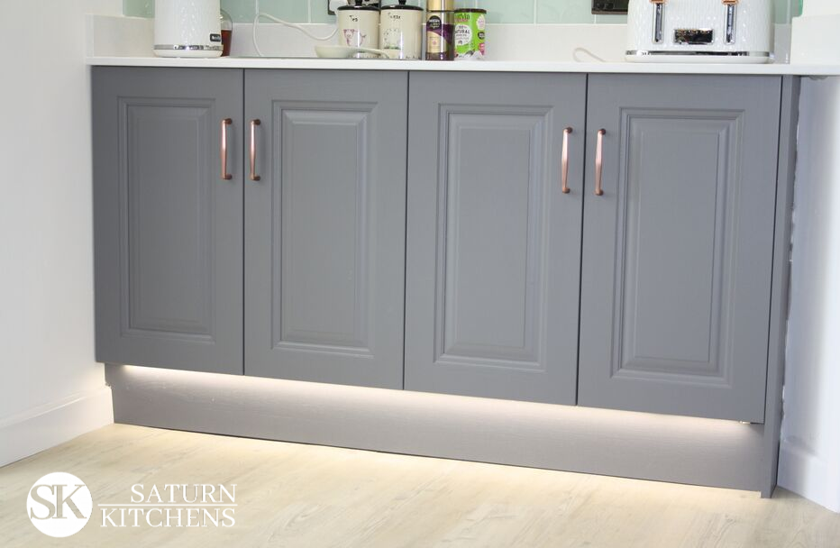 image of dark grey kitchen units with white worktop and under unit lighting