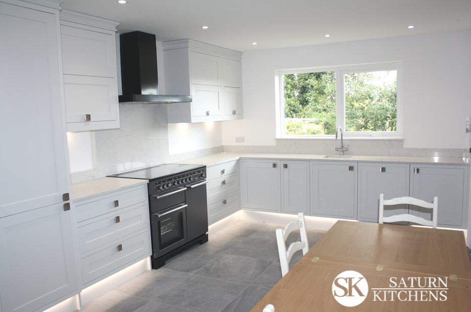 image of fresh, modern kitchen with white units and worktops and grey faux slate tiles
