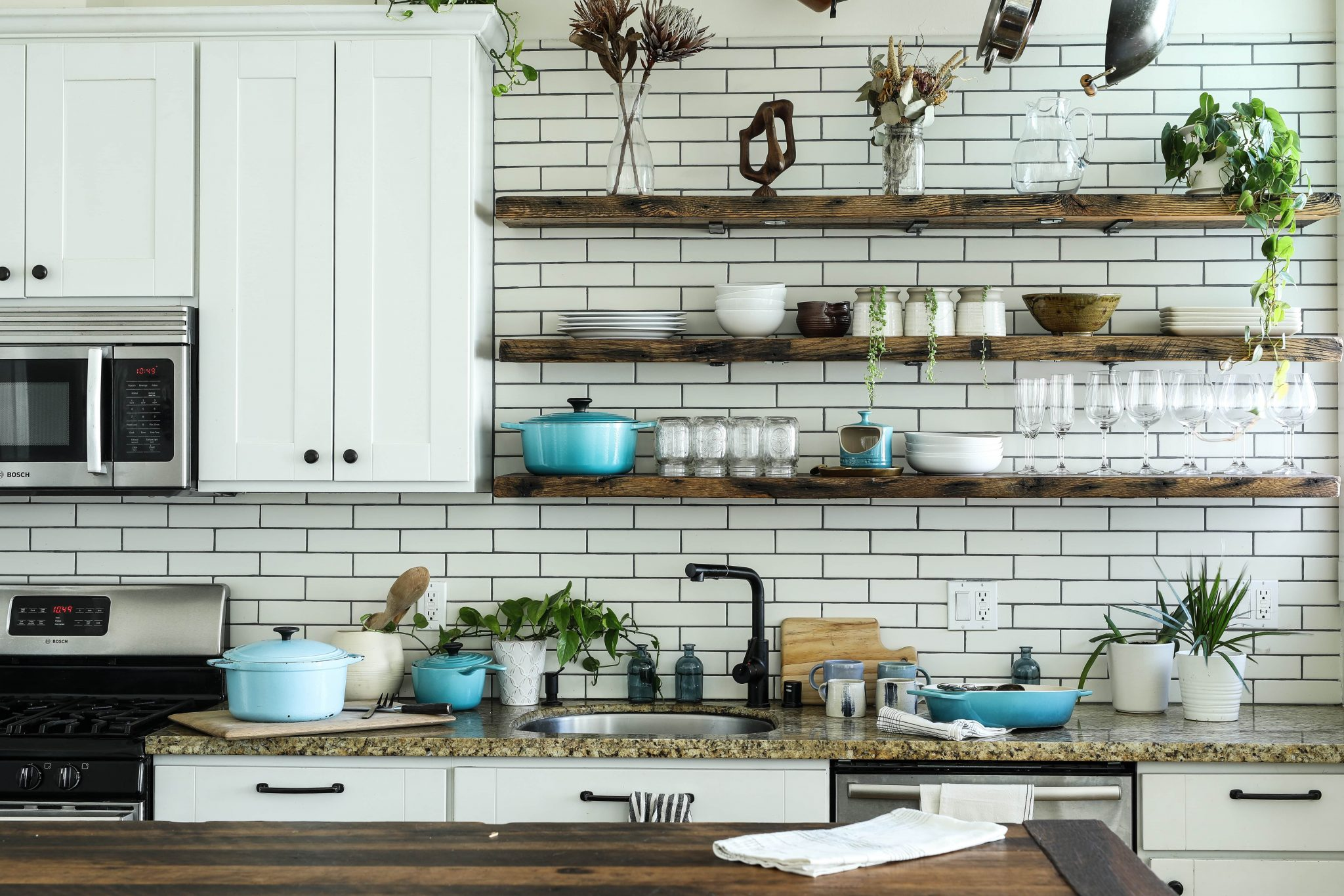 image of industrial kitchen with exposed white bricks