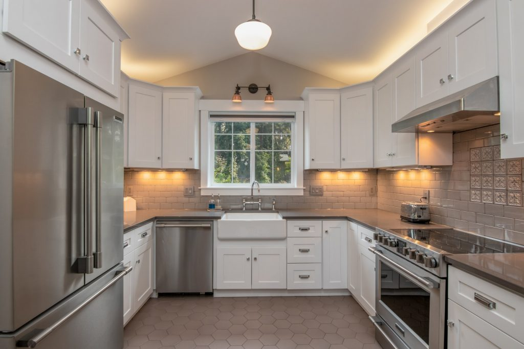 kitchen with stainless steel appliances like toaster, microwave oven and refrigerator