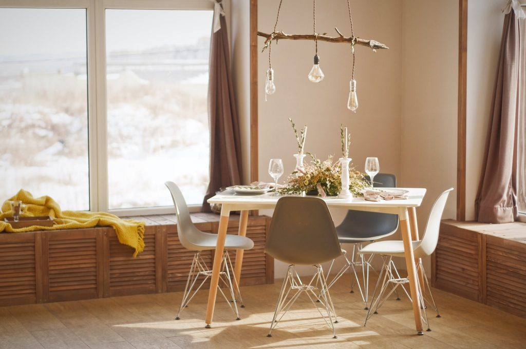 stylish rustic pendant lights over a dining table