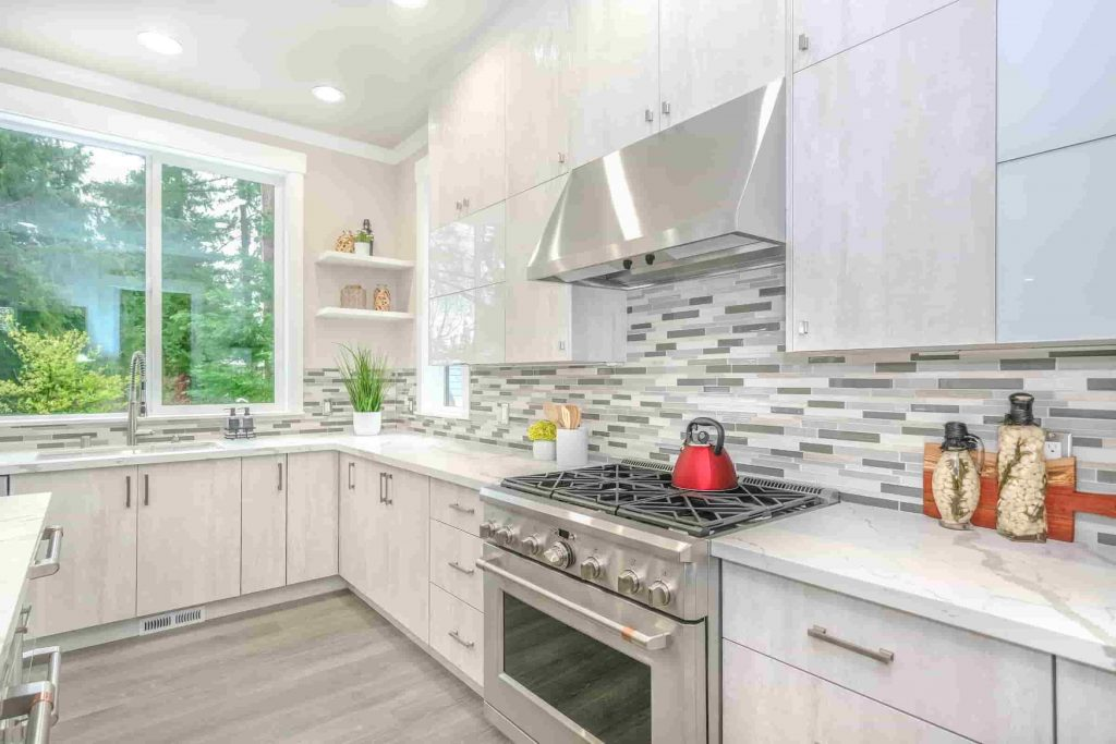 low maintenance kitchen materials; a white and grey themed open kitchen